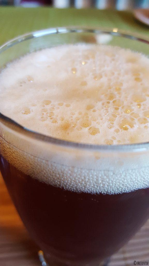 Bière IPA Corne du Diable de la brasserie canadienne et québécoise Dieu du Ciel ! servie dans un verre avec de la mousse !